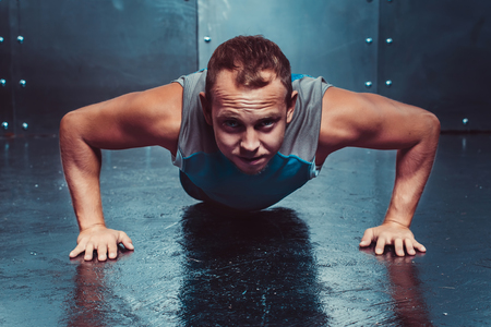 pushed: Athletic man trains, pushed forward looking. concept of health and strength