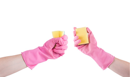 sanitizing: hand in pink rubber glove with sponge isolated on white