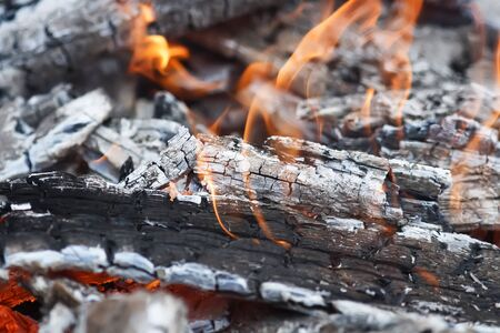 voile: burning up white hot coals and the bright red flames of a fire