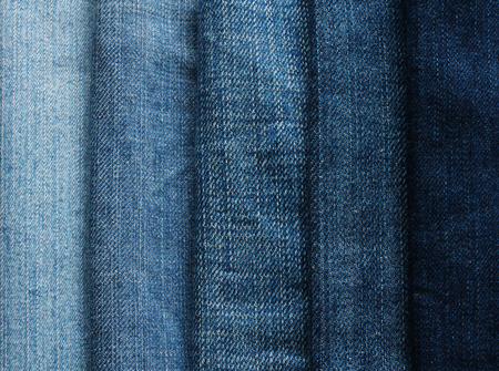 background from strips of fabric of blue jeans of different shades and brightness Imagens