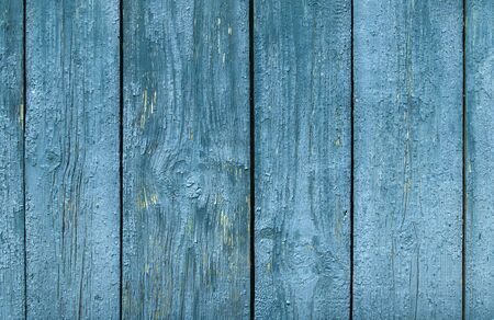 old wooden surface of the strips and planks from paint and cracked