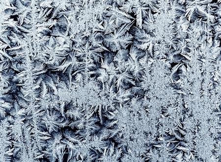 beautiful holiday background from a shiny frosty pattern on intricate blue glass Stockfoto