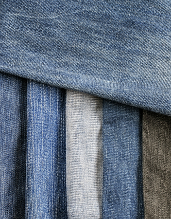 stylish textured background frame from strips of denim in different shades