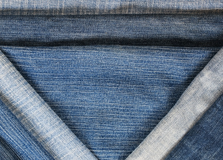 fashionable and stylish textured background with horizontal and diagonal stripes denim of various shades of blue Lizenzfreie Bilder