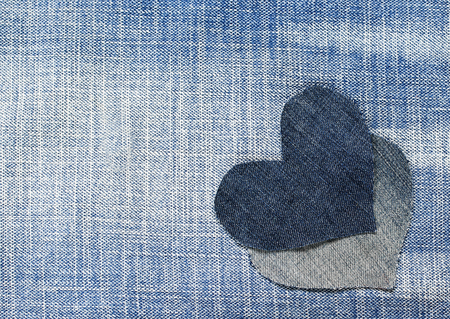 two hearts cut from blue denim in a stylish background