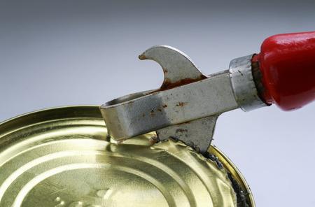 old rusty metal knife opens a metal tin