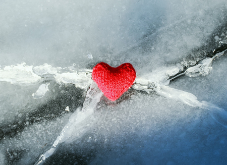 beautiful bright heart yarn is melted with heat and love the cold blue crack in the ice