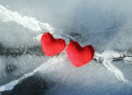 two warm red heart of the yarn on the crack the cold blue ice