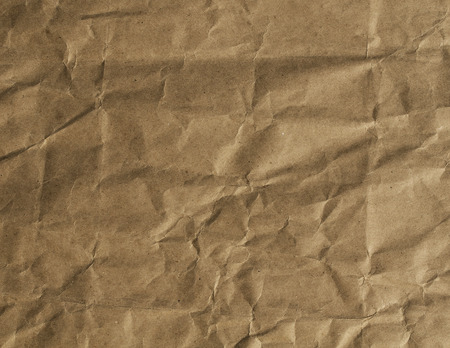 old yellow paper texture background with cracks and dents