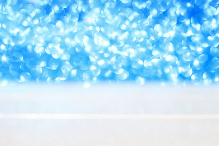 elegant beautiful festive background of white wooden table and shiny blue circles in the distance Stockfoto