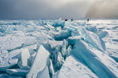 ice floes: people from the huge ice floes of lake Baikal at dawn
