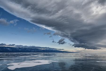 big cloud over the ice of lake Baikal