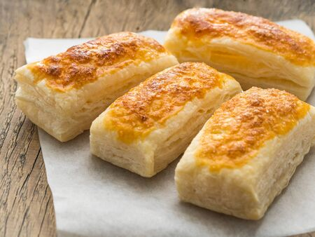 few fresh rolls with a delicious crust of puff pastry, close-up, selective focus,