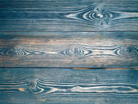painted in blue, dark blue, wooden background from pine boards, contrasting the structure of the tree with knots Banco de Imagens