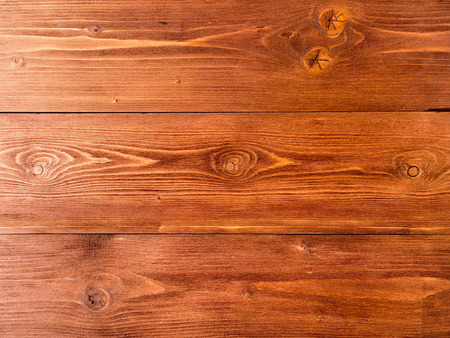 painted in brown, wood background from pine boards, contrasting the structure of the tree with knots Banco de Imagens