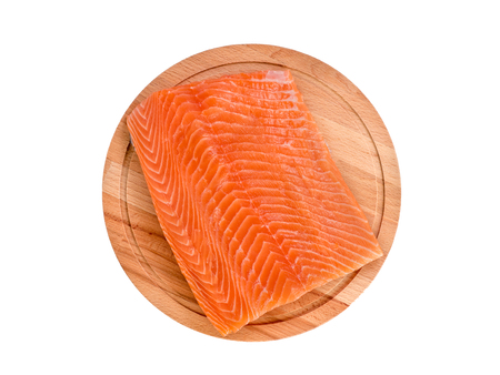 Fresh salmon fillet on wooden cutting board on white background, top view Stockfoto