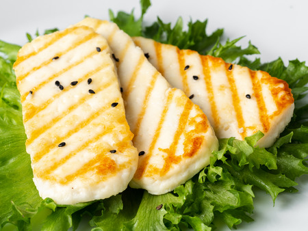 Grilled Halloumi, macro fried cheese with  lettuce salad. Archivio Fotografico