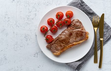 keto ketogenic diet steak with tomatoes on white background, top view copy space