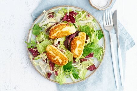 Cyprus fried halloumi with healthy salad mix.