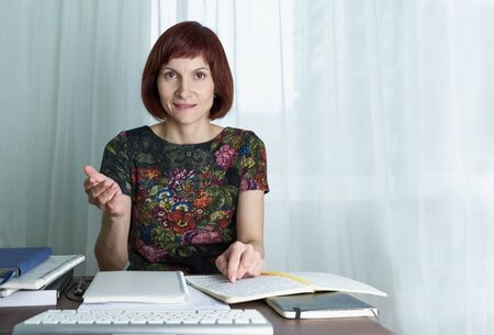 Distance education for students. Quarantine, self-isolation, sociophobia. Tutor conducts classes over Internet online lectures. Woman look at laptop.