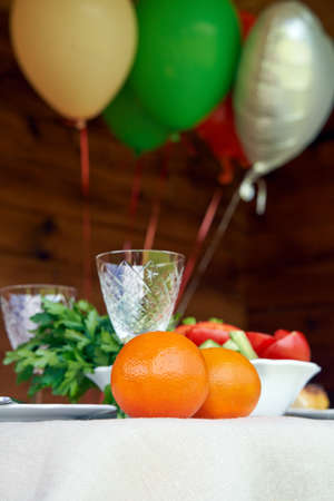 Table full of vegeterian food with air balloons on wooden background 免版税图像