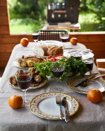 Holiday table full of food grill on background 免版税图像