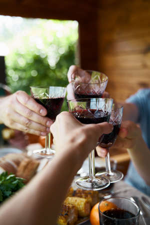 Hands with drinks in glasses celebrate party countryside