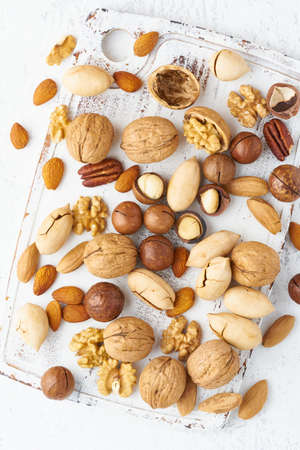 Mix of nuts - walnut, almonds, pecans, macadamia and knife for opening shell