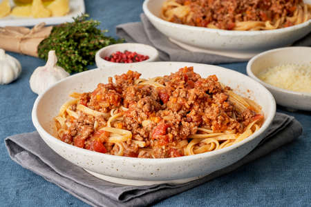 Pasta Bolognese Linguine with mincemeat and tomatoes. Italian dinner for two