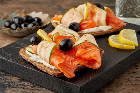 Smorrebrod - traditional Danish sandwiches. Black rye bread with salmon, cream cheese Reklamní fotografie