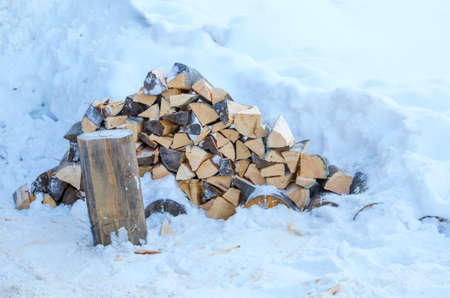 woodpile: the woodpile of firewood on snow Stock Photo