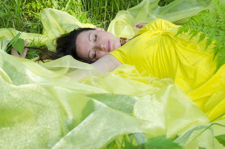 matter: The young girl sleeps on yellow matter in nature