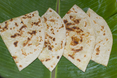 the Indian national dish naan on banana leaves