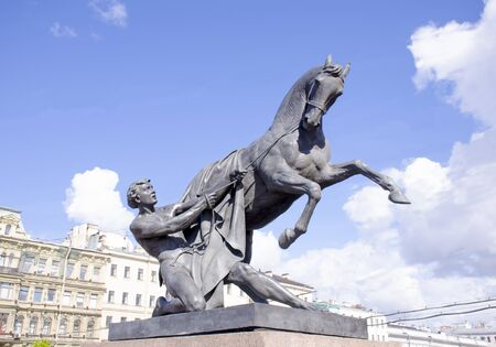 Sculpture of the tamer of horses on Anichkov Bridge St. Petersburg in Russia the city