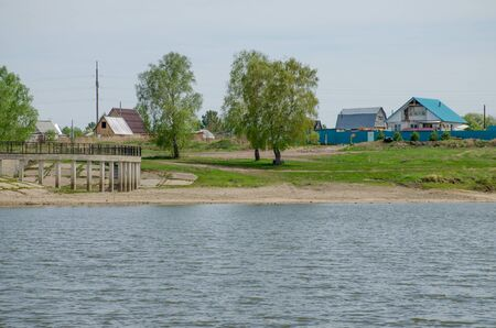 landscape lake in the spring to siberia