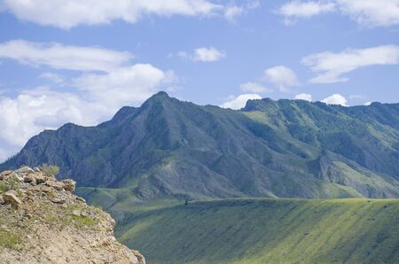 Landscape of taiga against the background of the high mountains of Altai in Russia