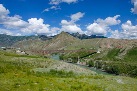 Landscape of Altai mountains and bridge over river