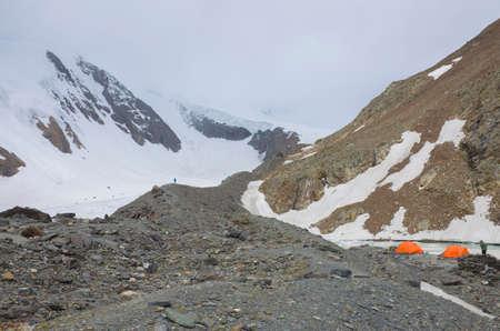 Tourist camp near the blue lake among the mountains is Aktru Glacier