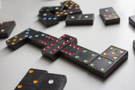 Black dominoes with colorful dots