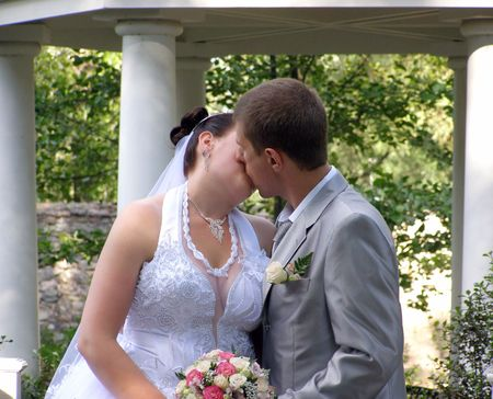 Romantic kiss of the groom and bride