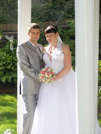 The groom and the bride in a garden Stock Photo - 7504450