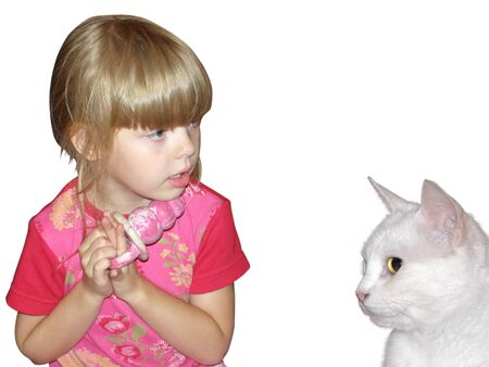 The little beautiful girl with a toy and a white cat photo