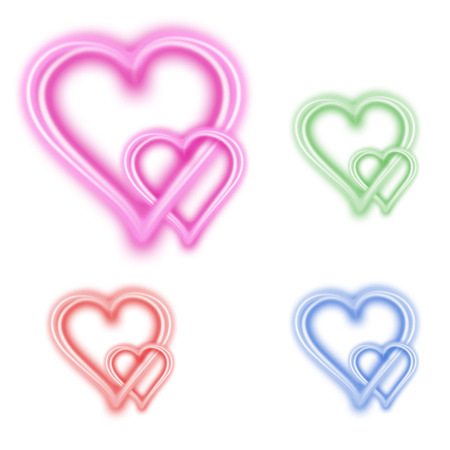 pink and green: Two hearts in different colors, pink, green, blue and red Stock Photo