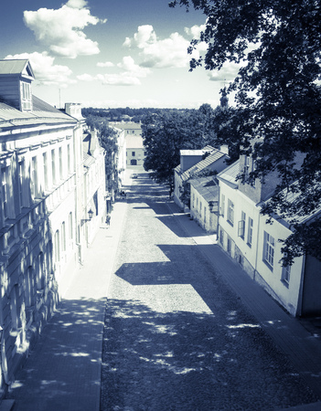 Street of the old town. Cobblestone road. Photo toned.