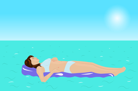 Girl in a bikini lying on the water on swimming air mattress
