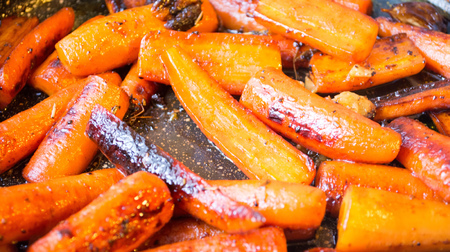 Glazed carrots cooked in a frying pan