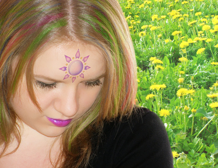 Fairy with multicolored hair on a dandelion field Stock fotó