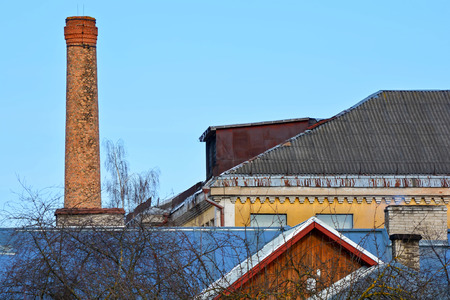 Roofs of old houses and brick chimneys.