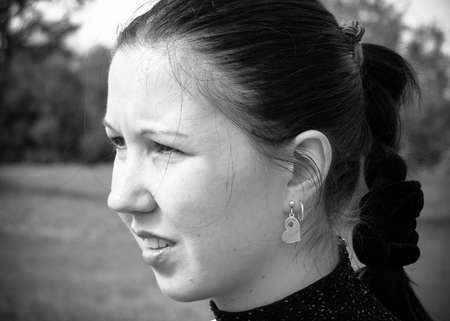 Black and white portrait of a girl who looks away Standard-Bild