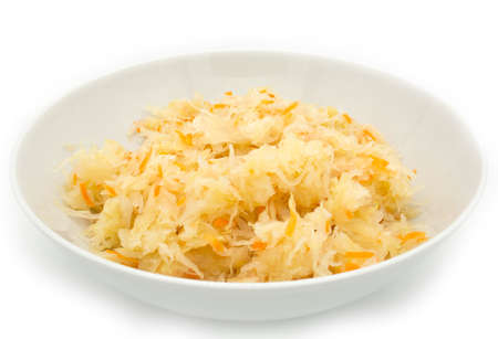 Sauerkraut with carrots in a white bowl, close up 免版税图像